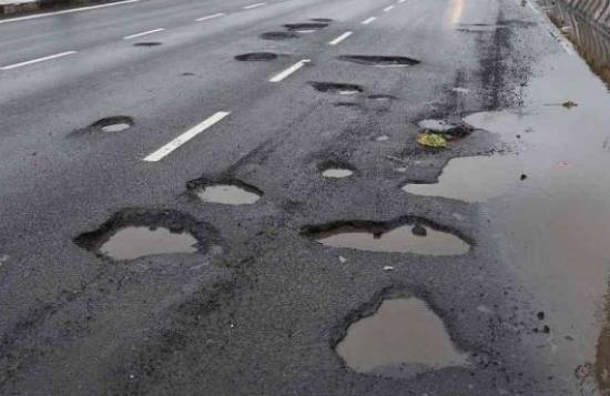 Photograph of Potholes - Would You Pay More Taxes To Fix Them